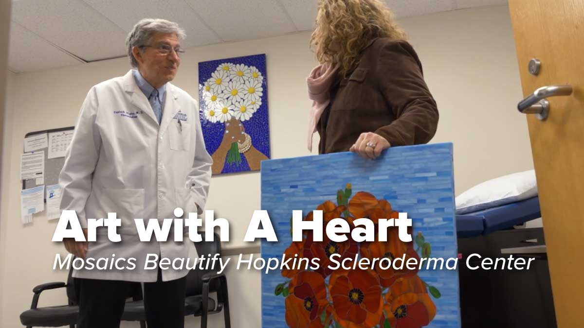 Dr Wigley and Donor with Mosaics for Hopkins Scleroderma Center